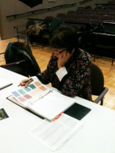Director, Holly Conroy reviews designs for Camelot.